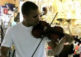 J. Cole playing violin